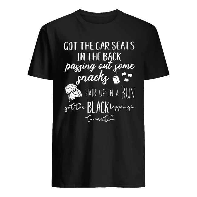 GOT THE CAR SEATS IN THE BACK PASSING OUT SOME SNACKS HAIR UP IN A BUN BLACK SHIRT